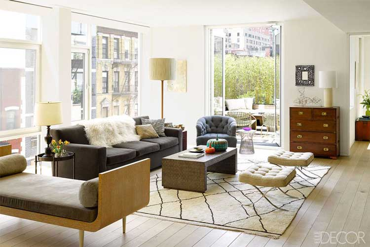 A Living Room with 3 Different Kinds of Chairs
