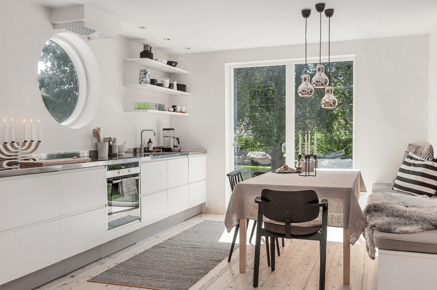 The dining room and kitchen in a Scandinavian home