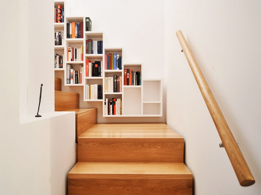 mini library on the walls of the house stairs