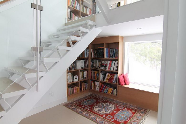 mini library under the stairs