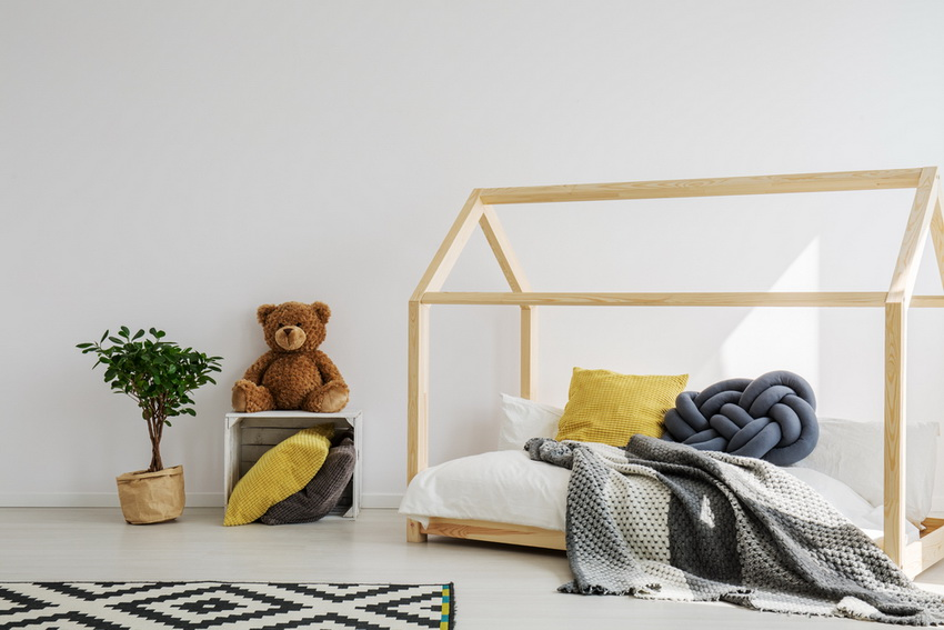 minimalist children's room with a bed frame resembling a home