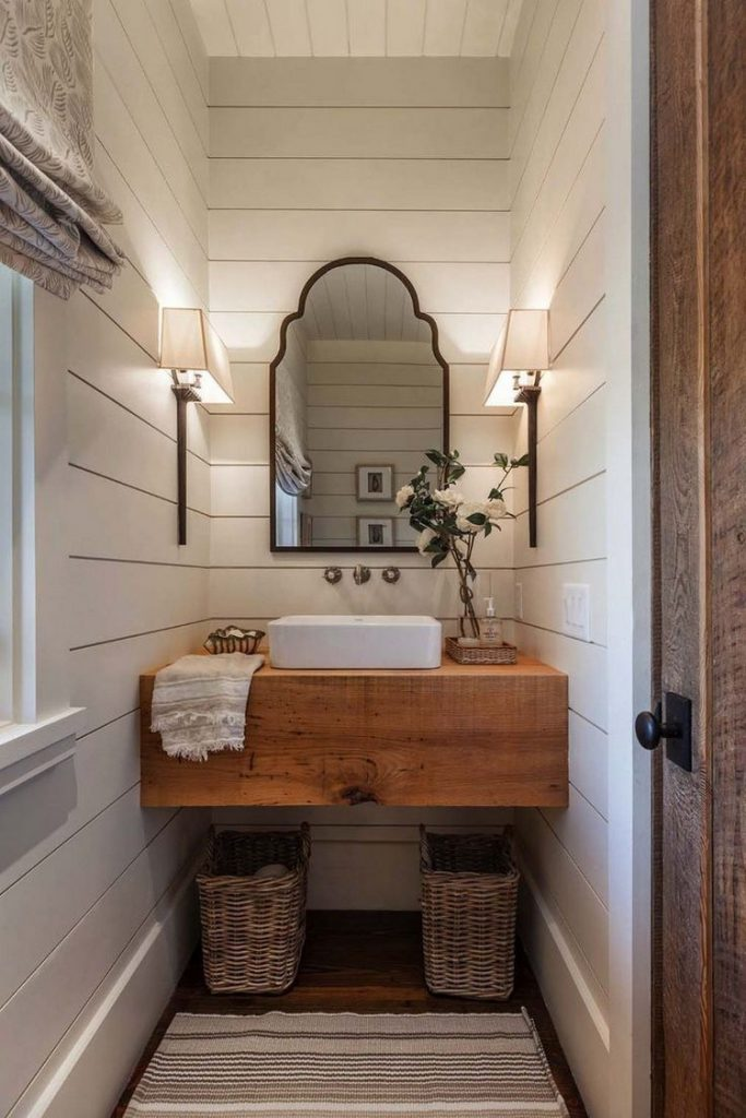 Bathroom under Stair in rustic style with a large mirror